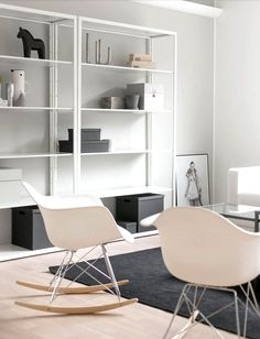 White metallic Ikea 'Fjälkinge' shelves WIth chairs!