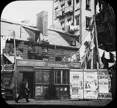 Five Points Tenements, ~ The Five Points gradually faded away into memory and legend.except for a few holdouts—wooden Five Points tenements, theater and musical ads pasted on a wall (lower right) near a store possibly on Worth St. New York City Pictures, New York Photos, City Hall Nyc, New York Chinatown, Nyc Pics, Gangs Of New York, Cities, Vintage New York, Vintage London