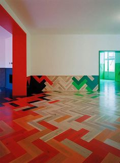 Stockholm apartment parquet flooring- Very colorful, but allows for creative ideas