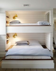 I love this! Perfect for a finished basement when guests are over! A top bunk for a kid and a bottom one for adults/parents!