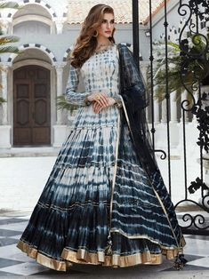 Superior multicolor digital printed gown online at best shopping price. Shop this latest gown style for diwali celebration. This alluring style set comprises a silk gown with matching net dupatta.