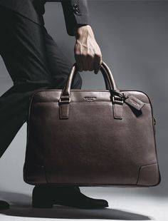 ★Bag by Coach. I have the Lite Brown one and luv it!!! Every man needs a bag......