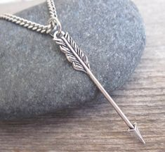 "Men's Necklace - Blackend Silver Plated Arrow Pendant - Mens Jewelry - Arrow Jewelry - Gift For Him  Looking for a gift for your man? You've found the perfect item for this!   The simple and beautiful necklace features blackend silver plated chain with an arrow pendant.  Length: 25"" (65cm).   Item will arrive in a pretty gift box as shown in last image, ready to give, with my brand logo.  $35"