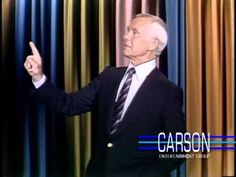 Johnny Carson tries to get through a joke with a little help from his staff