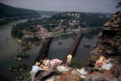 I grew up going to Harpers Ferry! It's kinda touristy and flat, but the narrow streets densely built up the hill make it feel like an old European city | People picnic on the rocky heights that overlook Harpers Ferry in Maryland, 1962. Photograph by Volkmar K. Wentzel, National Geographic Creative