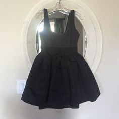La Rok Fit and Flare Flirty Dress Black and grey two tone dress. Fitted layer under the flared skirt to provide full coverage underneath. Plenty of spandex in the heavy cotton material to provide a lot of comfort. Worn twice. La Rok Dresses Mini