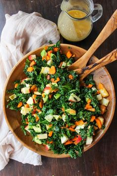 Crunchy Carrot Apple & Massaged Kale Salad topped with halloumi, avocado…