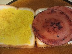 """The Bologna Sandwich, aka """"baloney sandwich"""" common in the United States and Canada. Fried or unfried, it has been elevated to a regional specialty in the Midwest, Appalachia, and the South. It is the sandwich served at lunch counters of small family run markets that surround the Great Smoky Mountains, and fried bologna sandwiches can be found on restaurant menus in many places in the South.The fried version is likewise sometimes sold at concession stands in stadiums, like those of the…"""