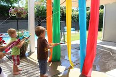 Fun Summer game - plastic table cloths from the dollar store and water shooters from the dollar store - hang up the table cloths, have buckets of water and shout out colors that the kids have to shoot.