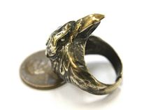 "Cast in solid silicon bronze, this raven head ring has been oxidized and burnished to enhance the realistic detail. The 1-1/8"" raven head blends perfectly into the feathered band with the beak positioned to sit low close to the finger."