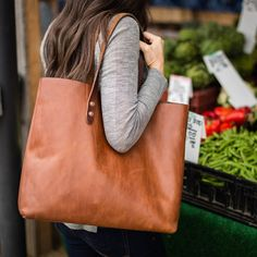 "The Vintage Tote Bag 15"" X 13"" X 5.5"" COPPER RIVETS, INTERIOR POCKET, SOLID BOTTOM. Definitely a wardrobe essential - would love in black! #fall #fashion"