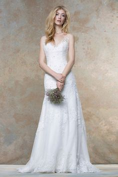 All Over Lace Sleeveless Fit and Flare Ivory Formal Wedding Dress Illusion V Neck