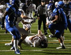 Federal Way's Andy Ah Fua breaks free from Issaquah's Jack Gellatly to score a touchdown. See more of Seattle Times photographer Colin Diltz's photos from the game.