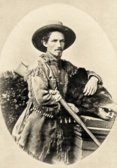 This successful, buckskin-clad sport hunter proudly poses with his ursine trophy. Balanced over the subject's arm is the weapon that no doubt brought the bear to bag—a Sharps Model 1874 sporting rifle made in Bridgeport, Connecticut. Long-cased metallic cartridges for the rifle are arrayed in a belt below the subject's elbow in this circa 1880-85 photo.  – Courtesy Dickinson Research Center, National Cowboy & Western Heritage Museum, 1994.10.1744 –