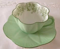 Wonderful vintage Shelley china tea cup and saucer made in England. This lovely green duo is in the Rose & Daisy pattern and dainty shaped.