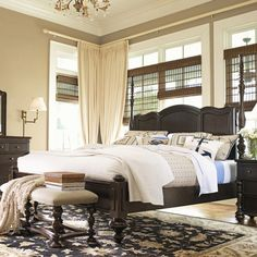 Bring provincial elegance to your master suite with this wood 4-poster bed, showcasing a carved scalloped headboard and turned details.   ...