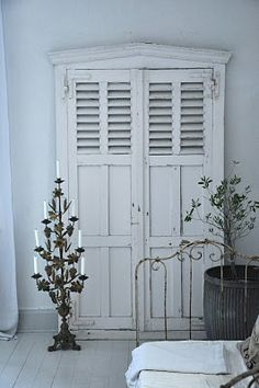A pair of old doors with an architectural element added on top are repurposed into a vignette that makes it look like you could open the door and walk into the next room. Old Shutters, When One Door Closes, Cool Doors, Vintage Doors, Shutter Doors, Closed Doors, Architectural Salvage, Windows And Doors, My Dream Home
