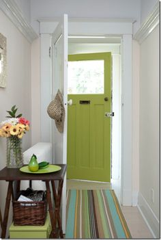 I SO want to re-paint my front door! I'm thinking yellow, but this green is fun too. :-)