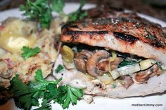 Pork Chops Stuffed with Mushrooms and Spinach http://motherrimmy.com/stuff-it-mushroom-and-spinach-stuffed-pork-chops/