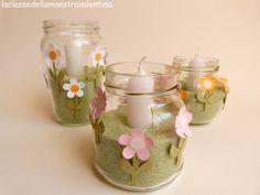 Vasetti di vetro decorati con candele