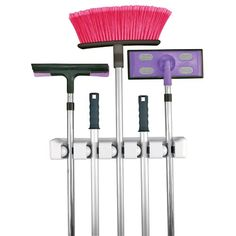 Snap your brooms in place to keep them off the floor and convenient. Also works for rakes and other yard-related tools. Evriholder Magic Holder 5-Position Wall Organizer http://www.amazon.com/dp/B0002V37ZM/ref=cm_sw_r_pi_dp_bN7Ftb0BQYS5PETZ