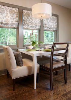 Instead of white trim, pull a darker neutral from the window treatments for more drama.