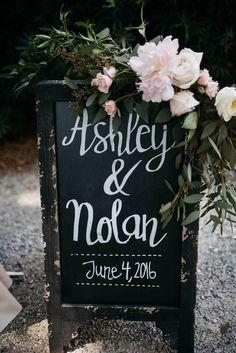Black wedding reception signage, soft light pink florals, leafy greens // Julia Madden Sears