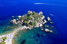 Taormina. I have to figure out what beach that is and I need to find it when I am there.