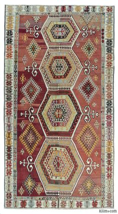 Vintage kilim rug handwoven in mid 20th century in the Konya region of Central Anatolia, Turkey. This kilim is woven as two pieces and then stitched together. It is in very good condition.