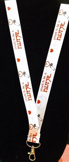 Proud to be a nurse lanyard made from wide grosgrain ribbon featuring an all metal swivel clasp and safety breakaway.
