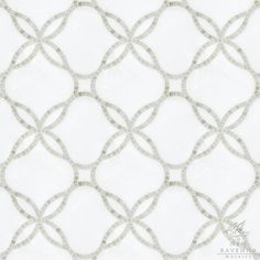 Waverly, a handcut and waterjet stone mosaic shown in Calacatta Tia (p) and Thassos (h), is part of the Silk Road Collection by Sara Baldwin for New Ravenna Mosaics.