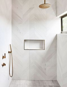 luxury bathroom Decor modern A Treetop Apartment In Noosa modern bathroom with modern white herringbone tile in walk in tile shower, white tile shower wiht gold shower head, minimalist bathrooom decor White Tile Shower, Gold Shower, Master Shower Tile, Shower Orange, Shower Niche, Marble Tile Shower, Tile Walk In Shower, Shower Over Bath, Window In Shower