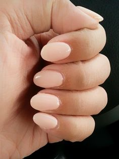 My manicurist mixed 2 gel colors to create this nudey-pink that compliments my skin tone. Short acrylic nails w/ oval tip.
