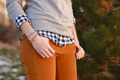 Gold corduroy pants + gingham and a grey sweater.
