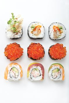 Sushi rolls, how yummy! I see salmon roe in the middle row!