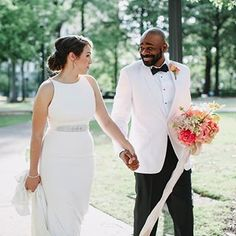How beautiful is this bride's modern column wedding dress paired with her bright wedding bouquet and her groom's white jacket for their Alabama celebration? | J. Woodbery Photography