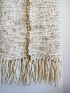 Chunky Ecru Textured wool blanket in a handmade thick and thin yarn. It is a super cozy wrap because the chunky natural organic merino wool yarn.