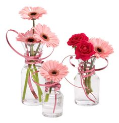 Pink OASIS Flat Wire added to Decanter Vases creates an energetic arrangement perfect for a Baby Shower or Birthday.