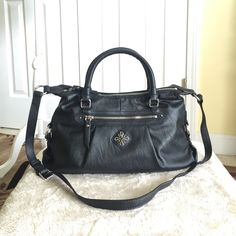 """Authentic Vera Wang Satchel Bag Authentic Vera Wang Satchel/Crossbody Bag. Style ASVH2542-1301 Danville Crossbody/Satchel bag. Color- Black. New with tag. Made of faux leather. Its a zip top closure purse with front zip pocket & fabric inside lining & multifunction slide pockets & zip pocket. Dimensions- 14.5"""" L (bottom) x 8"""" H x 4"""" W with handle drop height of 4.5"""" and long adjustable strap of 22"""" drop height. No dust bag available. Vera Wang Bags Satchels"""