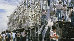 """The Parthenon of Banned Books, Buenos Aires, 1983: Volunteers build a full-scale replica of the Greek Parthenon out of books banned under Argentina's military dictatorship. Conceptual artist Marta Minujín chose to make this """"first monument of democracy"""" of books because """"books are vehicles of culture and thought,"""" she said  in a 2013 interview (in Spanish) at the site below. The structure was disassembled Christmas Eve day and the books distributed to schools, libraries and those present."""