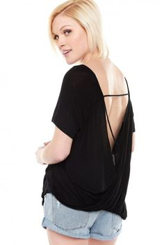 Not your every-day basic top, the Crossed Over Black Open Back Top goes to show it's all in the details. A classic rounded neckline and short sleeves show off a flowy tee-shirt bodice with an open back that crosses at the bottom and showcases strappy detailing. Effortlessly sexy and easy to style with any of your destructed denim, a bold statement necklace and an essential reversible tote! #top #black #basictop