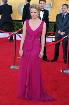 Dianna Agron complemented her fuchsia Carolina Herrera gown with a braided updo.