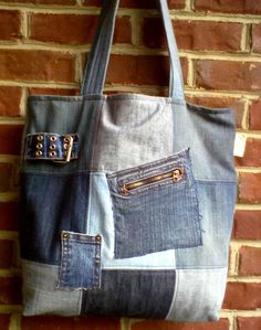 Re-purposed denim jeans, made into a large tote bag with 4 outside pockets and 2 inside pockiets. Tote is fully lined in a red homespun fabric.