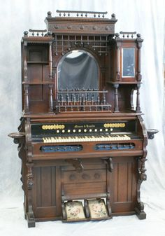 Mason and Hamlin walnut Victorian pump organ in working condition with mirrored stick and ball galleries, 84h 47w