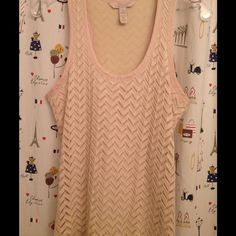 Banana Republic Heritage racer back crochet tank S If anyone has this in a L let me know! LOVE this gorgeous crochet tank from Banana Republic Heritage collection. It's feminine looking but with a sporty edge from the racer back. In like new condition because I bought the wrong size. For some reason the lighting is making it look pink but it's definitely a creamy natural color. Shirttail hem. Size S. Smoke free home. Banana Republic Tops Tank Tops