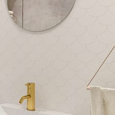 Bathroom by @bellander_arkitektur Fish scale tiles Brass tap Circle mirror Towel hanger in wood and leather