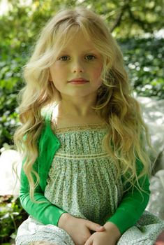 Gorgeous little girl in green. Looks like Olivia to me.