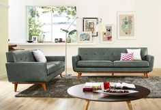 Lyon Smoke Grey LoveseatThe Lyon loveseat captures the essence of Mid-Century style that refuses to fade into obscurity. The gorgeous smoke grey eco leather is welcoming and adds charm to any room. The cushioned arms provide added comfort, while the small scale tufting adds a pop of personality. Handcrafted the Lyon collection will undoubtedly add style to your space, while the kiln dried solid wood frame will assure years of support and comfort.