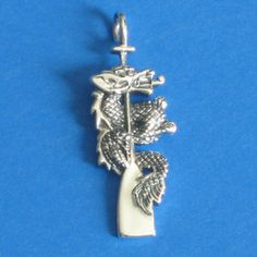 dragon wrapped around a boat paddle pendant. Paddle Boat, Dragon Boat, Silver Dragon, Paddles, Rowing, Dragons, Belly Button Rings, Jewelery, Beading