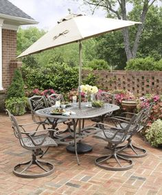 Home Styles 5557-335 Malibu 7-Piece Outdoor Dining Set, Taupe Finish by Home Styles. $1899.00. Comes in a taupe finish. Table measures 42-inch width by 72-inch depth by 28-1/2-inch height. Made of cast aluminum. Malibu 7-piece outdoor dining set. Set includes oval dining table and six swivel arm chairs. This malibu 7-piece outdoor dining set includes oval dining table and six swivel arm chairs. A contemporary alternative to the usual traditional design of outdoor di...